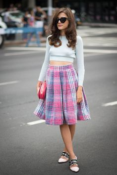 Eleonora Carisi managed to make the crop top look downright sweet with a full plaid skirt.