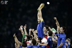Italy's Fabio Cannavaro lifts the World Cup Trophy after the World Cup 2006 final soccer match between Italy and France in Berlin July 9, 2006.