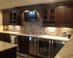 Basement bar...Concept similar to our layout. Under counter wine and fridge.