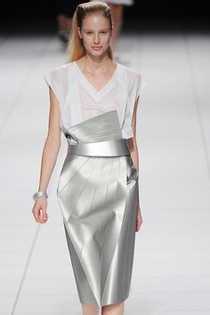 An architectural edge graced the #IsseyMiyake collection today. This silver skirt boasts incredible structure and shape #PFW
