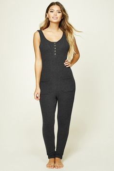 Crafted from a soft knit, this sleeveless PJ jumpsuit features a five-button front placket, two front patch pockets, and a cuffed hem.