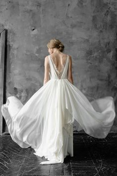 Amalthea // Simple silk and lace wedding dress with V-neck and button detail