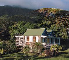 The Hermitage Plantation Hotel, Saint Kitts and Nevis, slumbers on several acres of stone terraces, with pastel guest cottages scattered among fruit trees fringed with tropical flowers. The individual cottages circle the 340-year old Great House, the social center of the plantation. The intimate Great Room (as with all the rooms and guest cottages) is furnished with antiques and period furnishings from old family collections. #Caribbean #Hotel