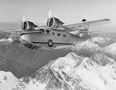 Grumman JRF-2 USCG over Alaskan mountains
