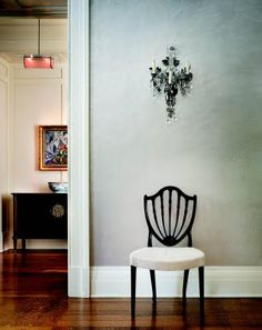 Shield-back chairs are classic and beautiful. I love one put by itself in a hallway like this so that its design can be fully appreciated. P.S. I really like that wall color.