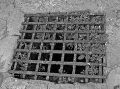 Sometimes all you would see is a metal grate and then you would quickly walk away. Looking the other way.  Pictured  is a possible oubliette at Pevensey castle.