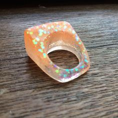 Citrus Orange Clear Sparkle Resin Ring Size 6 by AllisonCraftBoutique on Etsy https://www.etsy.com/listing/529970515/citrus-orange-clear-sparkle-resin-ring