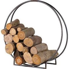 A spin on traditional log holders. Our circular log holder is a beautiful contemporary piece which is made from two pieces of metal which sit together to create a stunning, graceful design. With two feet - front and back, this makes our log holder sturdy Fireplace Logs, Modern Fireplace, Fireplace Design, Fireplace Furniture, Fireplace Ideas, Fireplaces, Furniture Decor, House Furniture, Contemporary Fireplace Accessories