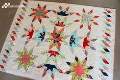 Lone Starburst quilt by QuiltFabrication