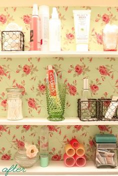 Sweet wallpaper in the medicine cabinet--love this idea for the middle of the vanity where the glass is gone.