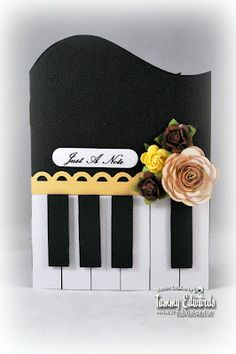 By Tammy Edwards. She used Cricut cartridges, but I could cut the curve at the top freehand and use cardstock rectangles for the keys. Sponge the edges of the white keys with black (or use black marker on the edges). Edger punch used. Flowers added.