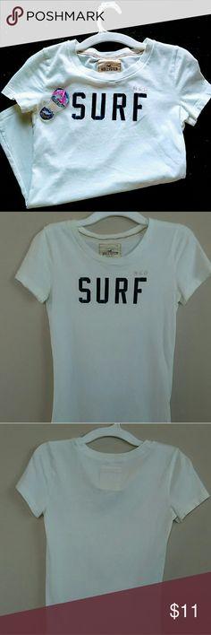 Hollister 100% Cotton T-shirt White Hollister T-shirt. NWOT. XS. Graphic text is in navy velvet. Hollister Tops Tees - Short Sleeve