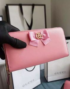 Gucci Bow Signature Zip Around Wallet in pink leather.  View more stunning designs at http://www.luxtime.su/