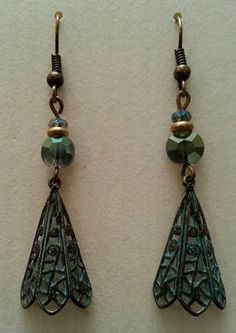 These earrings are made with lightweight brass filigree pendants, weathered in shades of soft blue and green, and accented with Czech glass beads. They are made with nickel-free ear wires. Nickel Free Earrings, Drop Earrings, Czech Glass, Filigree, Pendants, Brass, Pendant Necklace, Trending Outfits, My Style