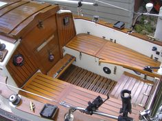 Pacific Seacraft Flicka 20' Cockpit - cockpit was customized with what appears to be lots of beautiful teak. Beware: lots of wood on the exterior of a boat translates to lots of maintenance!