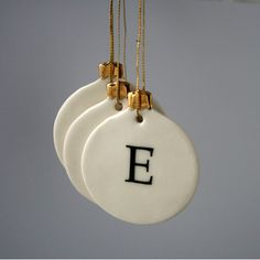 sweet personalized christmas ornaments from joheckett on etsy.  would make lovely favors!