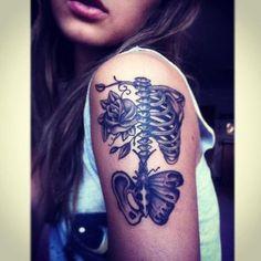 Skeleton skull boho outter arm tattoo