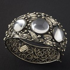 Mary Gage Arts and Crafts silver and crystal cuff. View 1.
