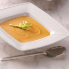 """Cream of Butternut Soup Recipe -Ginger, turmeric, cinnamon and a little sherry do an incredible job of seasoning this slightly sweet soup. """"After I lightened up a recipe from a friend in South Africa,"""" explains Lafayette, Colorado's Shelly Snyder, """"it quickly became a family favorite."""""""