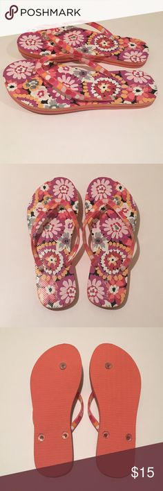 "Vera Bradley floral flip-flops 7/8 medium like new Vera Bradley floral flip-flops in like-new condition, Pixie Blooms pattern. Never worn outside. Tried on a few times indoors but they are too small (I really wanted them to fit!) Tags removed except ""M"" size stickers still in place. These are well-made, sturdy construction. Size medium is listed as 7/8. I included a photo with measurements length 10"" with across ball of foot 4"". Thickness 10/16"" (A little more than 1/2""). Great for a cruise…"