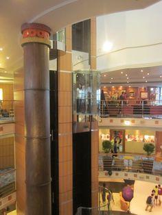 - Atrium with Glass elevator Norwegian Sky Cruise, Glass Elevator, Atrium, Liquor Cabinet, Storage, Furniture, Home Decor, Purse Storage, Decoration Home