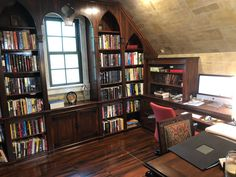 """When we first moved into our house, my office was nothing but a bland, beige bonus room over the garage. With the help of an interior decorator, a carpenter, and a very skilled faux-finisher, we transformed it into a pseudo-medieval/Gothic office cum library that seemed to me the perfect lair for a fantasy writer. These photos show my writing nook and the other end of the office. I skipped taking photos of the parts in between, where my art supplies continue to take over."" Diy Furniture Board, Book Nooks, Reading Nooks, Bookshelves, Bookcase, Gothic Room, Dream Library, Interior Decorating, Interior Design"