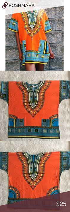 Orange Dashiki 100 cotton!  Made in Thailand, however purchased in Nigeria and 100% authentic! (Super popular in W. Africa and abroad) This dashiki is unisex and one size fits most. Therefore it will be an oversized style for those who are extra small to medium! Pair it with a belt, over the knee boots, wear it as a top, a dress, or a tunic. So many style options!  Length: 29.5 inches and bust: 59 inches  No trades, please! 0001181700ng dashiki Tops