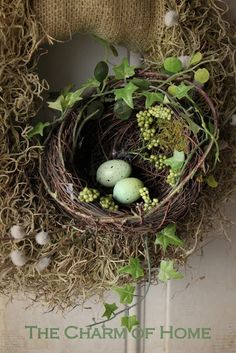 The Charm of Home: A Spring Wreath Love the nest in the mossy wreath