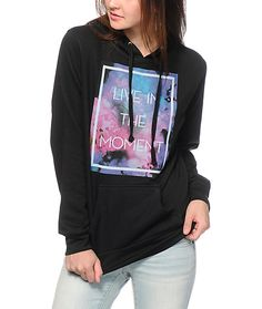 """A watercolor box graphic with """"Live In the Moment"""" lettering is printed on a fitted hoodie made wit ha soft fleece construction for a comfortable look that is sure to inspire."""