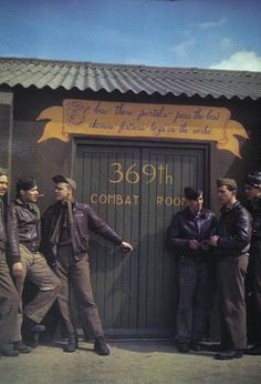 Personnel of the 369th Bomb Squadron, 306th Bomb Group outside the combat room at Thurleigh ~