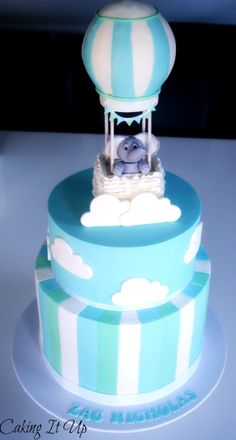 Hot Air Balloon cake in blue, green and white with a gorgeous elephant in a hot air balloon topper www.facebook.com/cakingitup