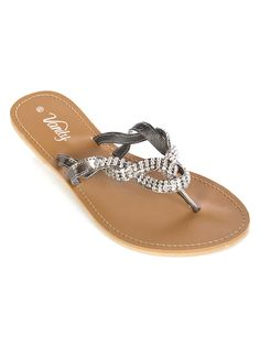 """Strut around in style with these slip on fashion sandals featuring a twist detail with rhinestones, flat insole and textured outsole. 1/2"""" heel height. Imported. FINAL SALE, NON-RETURNABLE............... evanity.com"""