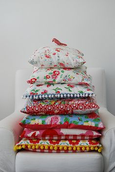 Whimsical, colorful pile of pillows. Could make from repurposed tablecloths. For inspiration.