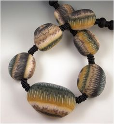 In this workshop, students will gain a solid understanding of how to make the canes I use in my current work, using hand pigmented, translucent polymer clay.