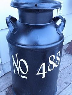 for milk can on front porch. good idea for the one I have from my Grandfathers dairy farm:)
