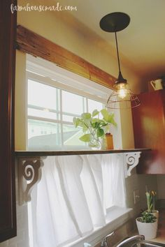 5 DIY's To Add Farmhouse Style How to transform a builder-grade kitchen to a rustic kitchen with simple updates!How to transform a builder-grade kitchen to a rustic kitchen with simple updates! Kitchen Window Shelves, Shelf Over Window, Kitchen Windows, Over Sink Shelf, Window Shelf For Plants, Kitchen Window Decor, Kitchen Soffit, Kitchen Floors, Side Window