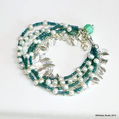 White Pearl Bracelet with Teal Glass and Silver Leaves, Multi Strand Pearl and Vintage Beaded Bracelet, WillOaks Studio Original. $42.00, via Etsy.