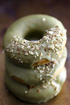 Soft and cakey, baked doughnuts with a sweet matcha icing. #vegan #matcha #doughnuts