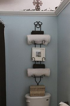 Plate holder as a towel rack hunting down a 6 tiered holder to do this & Use the large 2-pane green window frame repainted and distressed ...