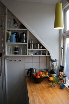 danish kitchen shelving, squeezed into tiny spaces