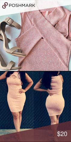 Beautiful Peach Colored Dress Worn only to photograph                                   Sweater Like Dress                                         Criss Cross Design Detail                                Very Stretchy (4% spandex) Dresses