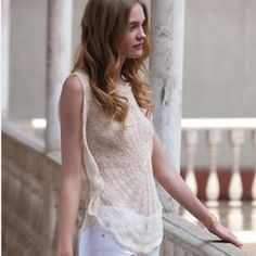 ANTHRO FAR AWAY FROM CLOSE TOP ANTHROPOLOGIE FAR AWAY FROM CLOSE TOP. BEAUTIFUL crocheted lace top in cream. Never worn. Needs camisole underneath. Beautiful and delicate. Anthropologie Tops
