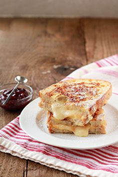 Meatless Monte Cristo Recipe A Monte Cristo for the meatless bunch. Smoked cheddar and Swiss melted between layers of egg-battered bread, and then fried until golden brown and perfectly melty. And then it's served with strawberry jam. Yes, seriously! Vegetarian Sandwich Recipes, Grilled Cheese Recipes, Bacon Recipes, Seafood Recipes, Vegan Recipes, Monte Cristo Sandwich, Wrap Sandwiches, Vegan Sandwiches, Queso