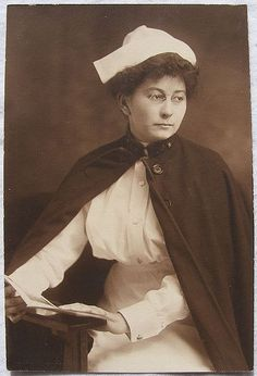 Portrait of an early 20th century nurse in full uniform. #vintage #nurse #cape #uniform