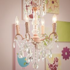 Crystal Center 4 Light Chandelier from Carousel Designs.  Crystals, crystals, crystals! This exquisite 4 arm pink chandelier sparkles with French cut crystals and bowls. A stunning addition to any decor! Chandelier holds 4 40-watt candelabra bulbs.