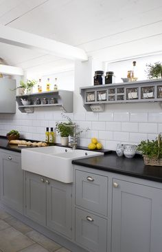 Kitchen in Grey, notice the famous Swedish glass jars in the shelf #Scandinavianstyle #Greykitchen #Glassjar #SolaKitchens