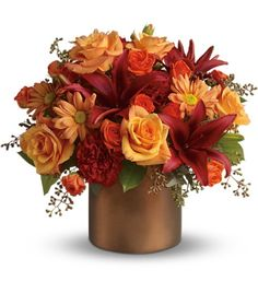 LOVE THESE FLOWERS - Gorgeous orange roses, spray roses and chrysanthemums, dazzling burgundy asiatic lilies, red carnations, and eucalyptus and even preserved yellow oak leaves (Red orange gold & blue) Autum Flowers, Fresh Flowers, Beautiful Flowers, Thanksgiving Flowers, Flower Centerpieces, Autumn Centerpieces, Red Carnation, Order Flowers Online, Flowers Delivered