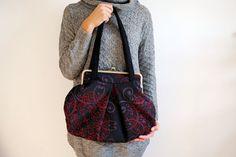 oriental kisslock bag. Embroidered black bag. black purse. kisslock purse. metal frame bag. large black bag. on Etsy, $100.00