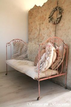 Antique daybed. Looks like a childs bed now, but it was probably an adults daybed once upon a smaller-peopled time!