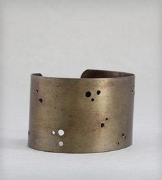 Solid Brass Cuff Bracelet by Elaine B Jewelry on Scoutmob Shoppe. This rustic cuff is drilled with various sized holes to give it lots of personality.